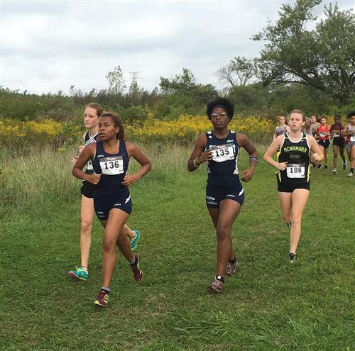 Crystana Vega-Allen & Delois Ivery compete at the Illiana Christian Invite