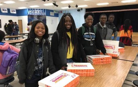 Hillcrest BPA students preparing to sell their donuts: (L to R) Tia Pollard, Alleya Arzu, Delois Ivery, Pierre Tutson, and Raqeeb Yarrow.