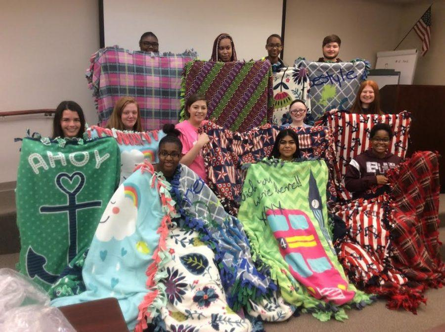 Displaying+the+blankets+they+made+for+the+domestic+abuse+center%2C+students+from+Hillcrest%2C+Oak+Forest%2C+and+Bremen+continue+to+contribute+to+their+community.