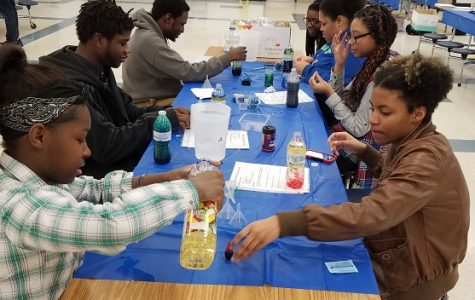 Students use various colors and liquids to make