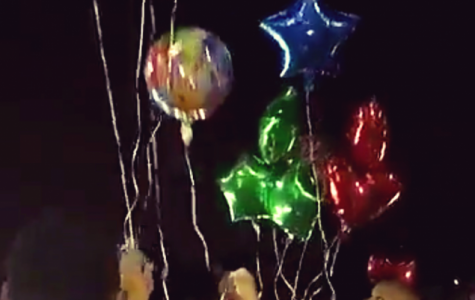 Hillcrest students and alumni release balloons in memory of Mr. Keith Anderson.