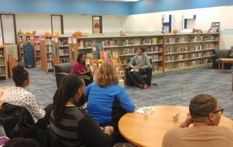 Jaden Luckey ('19) interviews author and Hillcrest alum Ashley Pickett on Family Reading Night in the Hillcrest IMC. 11/14/17