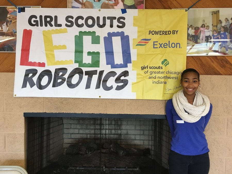 Courtney+Hollis+volunteers+at+the+Girl+Scouts+Lego+Robotics+Competition.