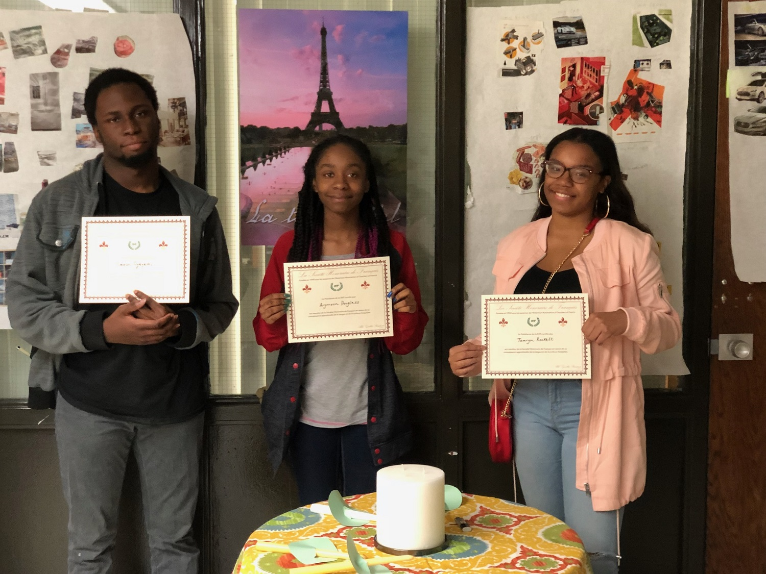 Hillcrest seniors Timeon Oyeyemi, Aryrreon Douglass, and Tamryn Rockett are inducted into the National French Language Honor Society.