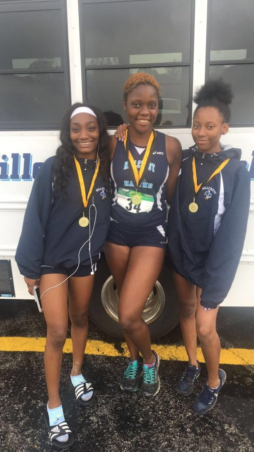 Teya Lewis,Gloria Agblami, & Aniya Matthews show off their medals after the Colonel Madden Cross Town Meet in Oak Forest. (10/6/18)