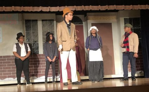 "Torrence Jones sings ""Christmas Children"" in the Hillcrest Drama Group Presentation of ""Scrooge: The Musical."""